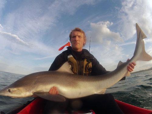 Kayak angler Gary Robinson with his Irish specimen tope.