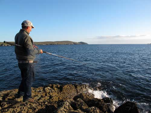 Rock fishing for mackerel and pollack on the Beara Peninsula, West Cork, Ireland.