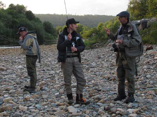 Denis O'Toole (centre) and Chris McCully (right) talk sea trout while Dean Kennedy (left) prepares.