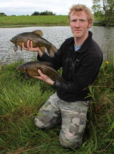 A brace of tench for Gary Robinson.