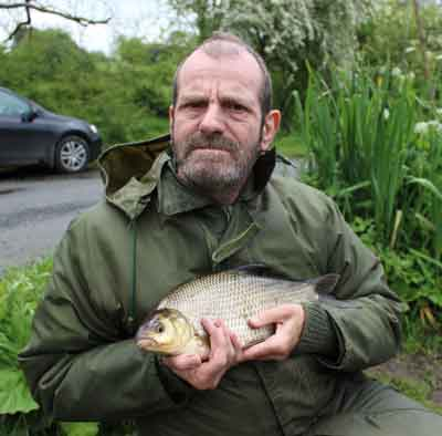 UK coarse angler Andrew Woods with a fine River Barrow hybrid.
