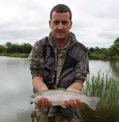 A fully finned rainbow trout in great condition, Ardaire Trout Fishery, Mooncoin, Co. Kilkenny, Ireland.