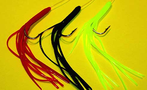 "Shamrock Tackle's ""Munster Mawlers"" jigs in red, black and chartreuse, ideal for pollack and cod."