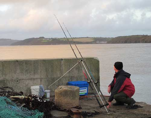 Pier fishing the Waterford estuary, Ireland.