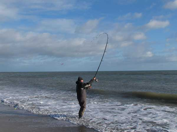 Winter beachcasting off Clone strand, Co. Wexford, Ireland.