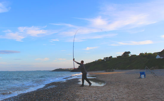 Evening sea fishing off Ballymoney strand, Co. Wexford, Ireland.