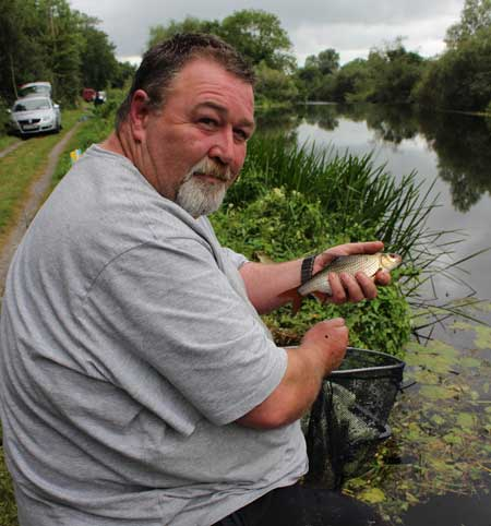 Padraig O'Riordan fishing the Barrow Bonanza 2015 Match with an average roach.