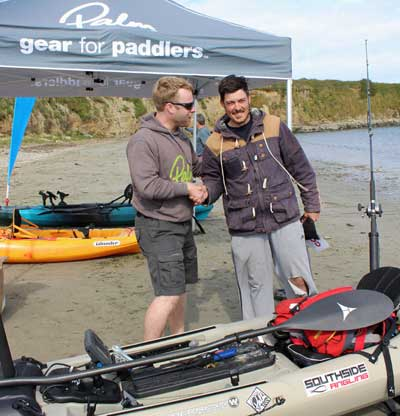 rish Kayak Fishing Open 2015 winner Ian Burton receives his prize from Shane Cronin, MD of event sponsors Progressive Distribution.