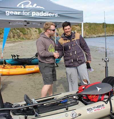 rish Kayak Fishing Open 2015 winner Ian Burton receives his prize from Shane Cronin, MD of event sponsors Progressive Distribution.