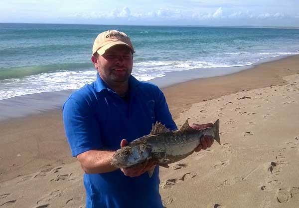 Welsh sea angler Daron Lawry displays a fine shore caught  Wexford bass.