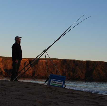 Beach fishing for bass in County Wexford, Ireland.