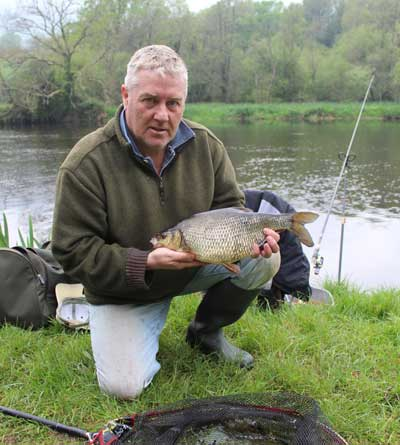 A 3.5 lb River Barrow Hybrid and one happy coarse angler.