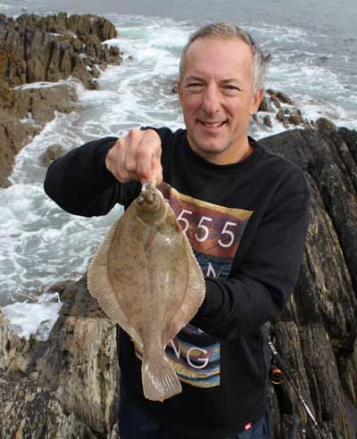 Tourist sea angler David Hoskins lands a nice Beara Peninsula dab.