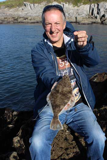 Beara flounder to a happy sea angler.