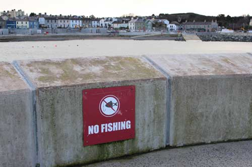 "A ""no fishing"" sign on the pier of Greystones, Co. Wicklow."