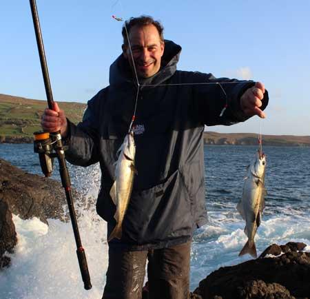 A double header of Beara coalfish for tourist sea angler Roger Ball.